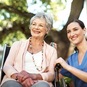 Shot of a young nurse spending time with a senior woman in a wheelchair in the garden